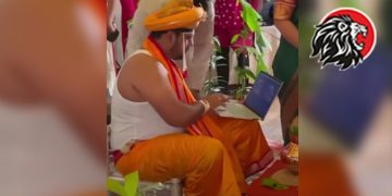 Groom Sits On The Mandap With His Laptop